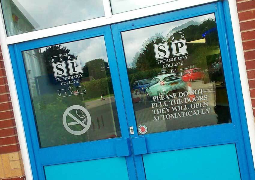 Informative graphics in the glass of the school's main doors