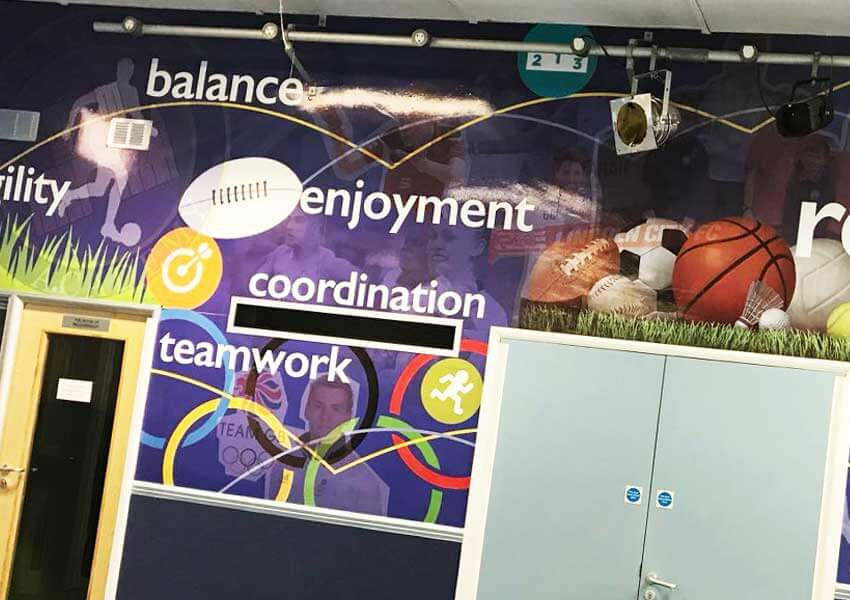 A wall display transforming the sports hall.